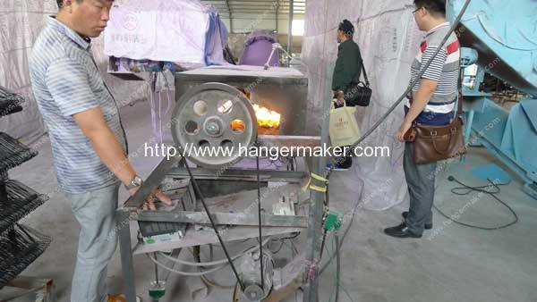 India Customer Visit Hanger PE Powder Coating Machine in Hanger Making Factory