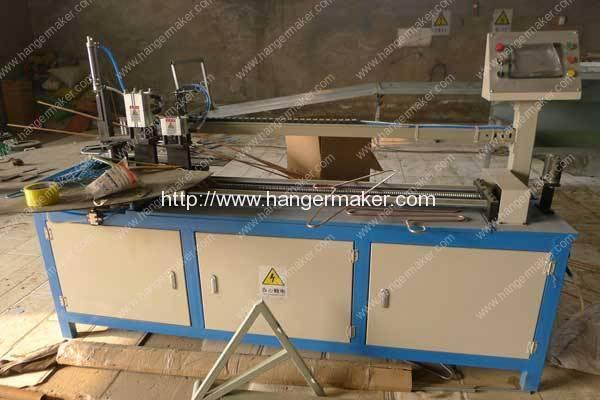 Автоматическая машина для изготовления вешалок для труб